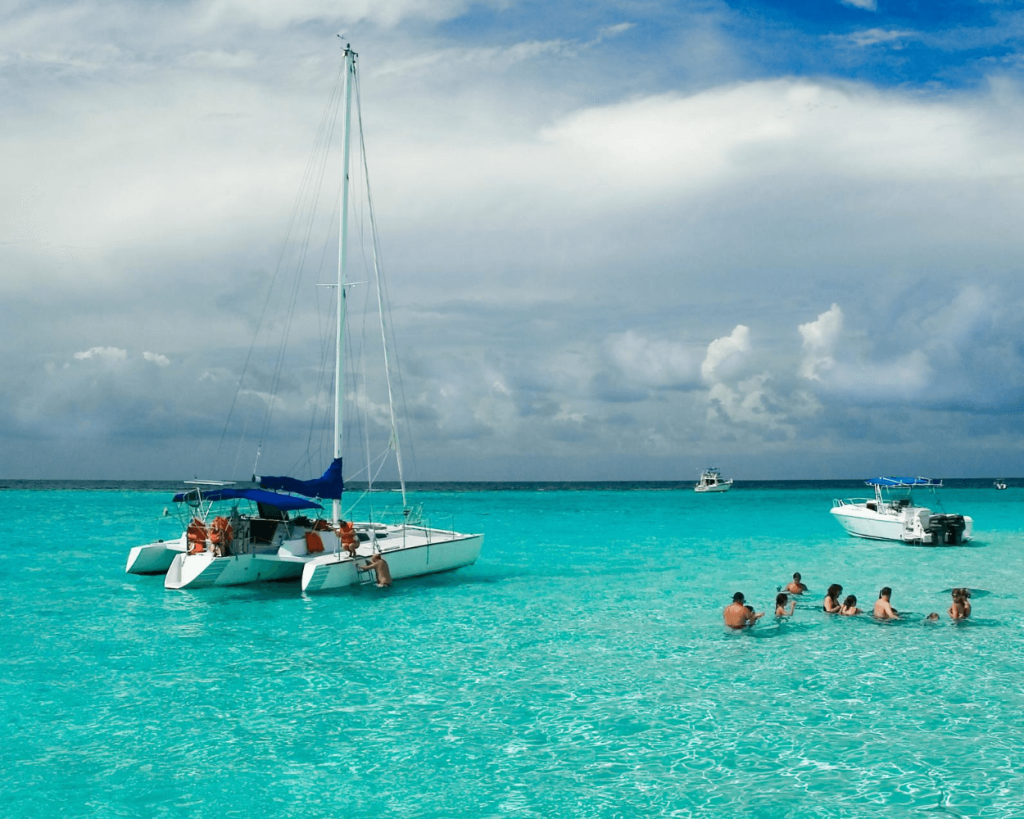boats and catamaran on snorkeling tour in cozumel mexico