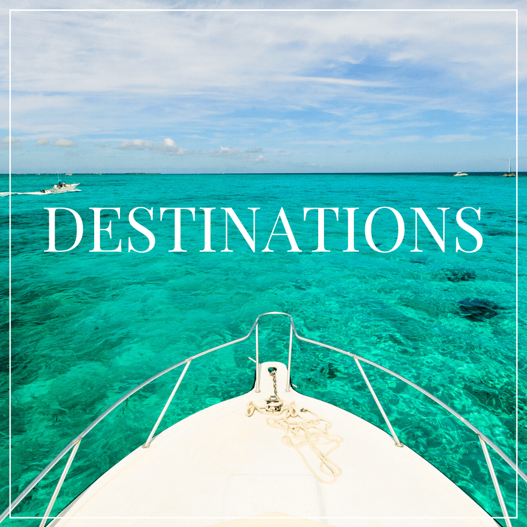 "boat bow on blue green caribbean water, text overlay ""destinations"""