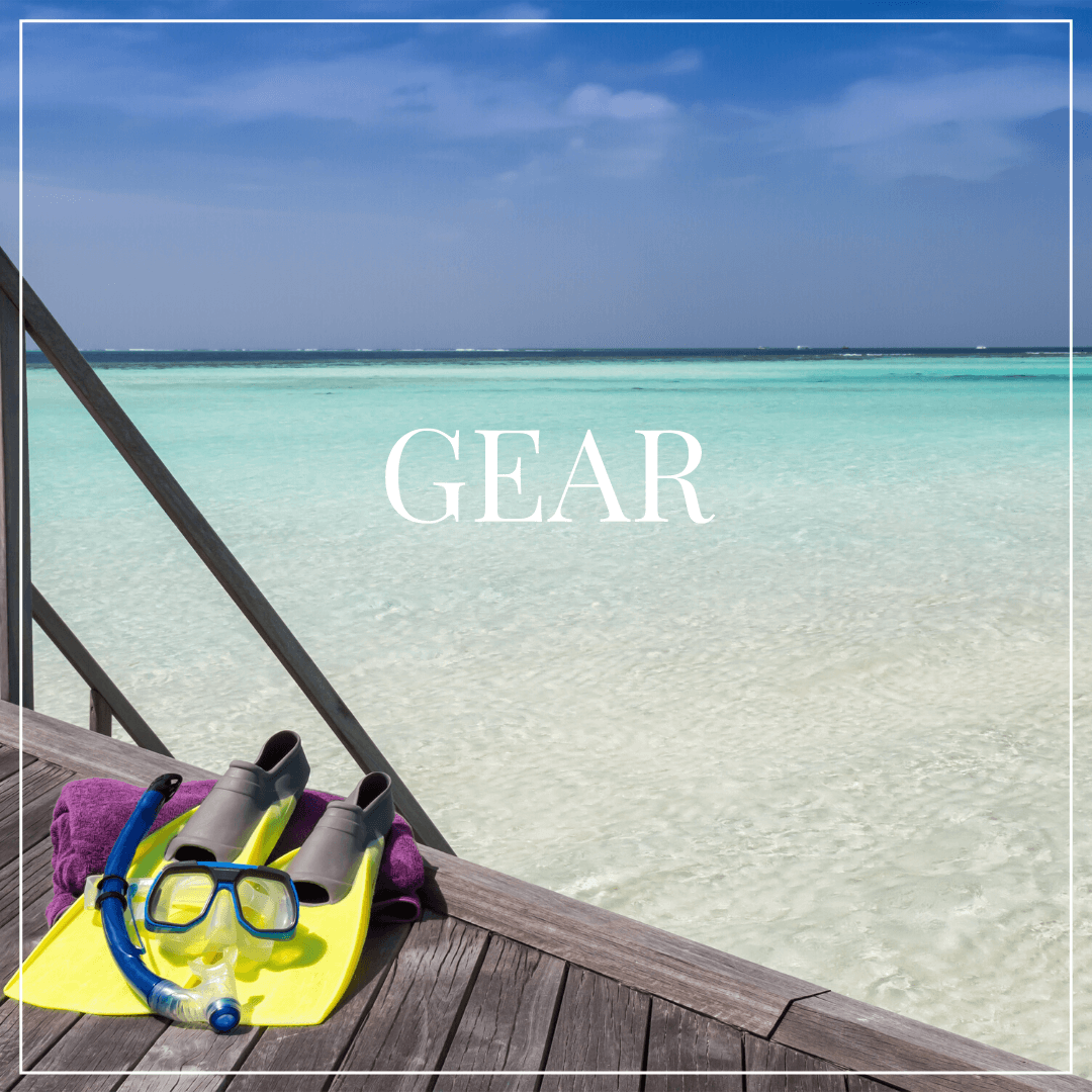 Gear text overlay, snorkel gear on dock with blue caribbean water in background