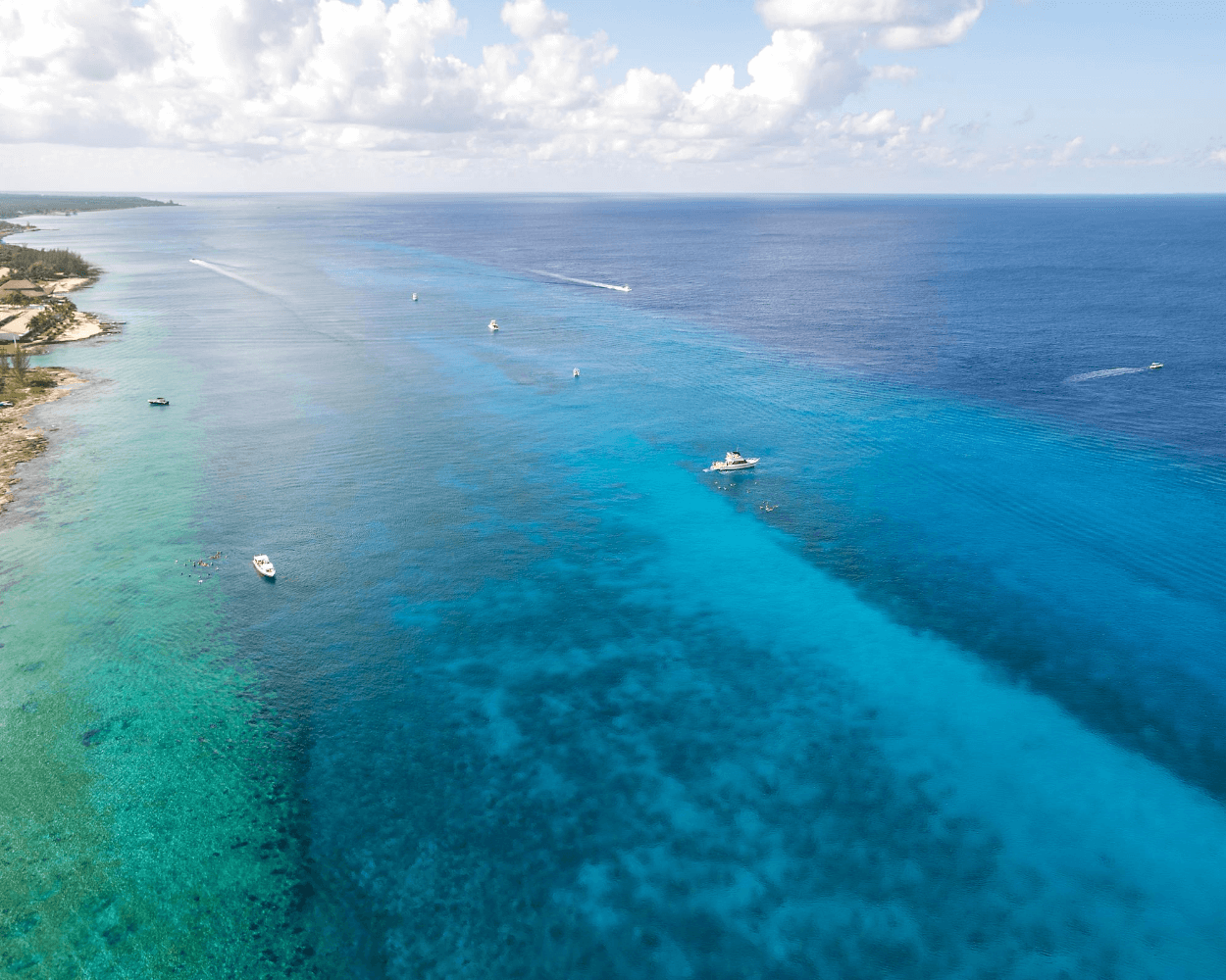 aerial view of boats and snorkel tours at paradise reef off the coast of cozumel mexico