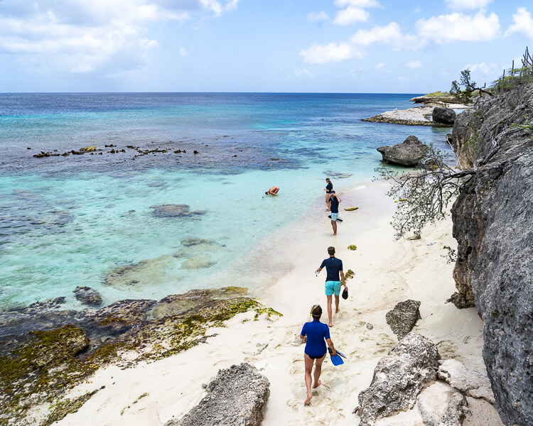 Snorkelers walking down to beach at Playa Funchi in Bonaire