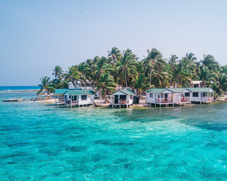 cabins on the water at Tobacco Cay in Belize