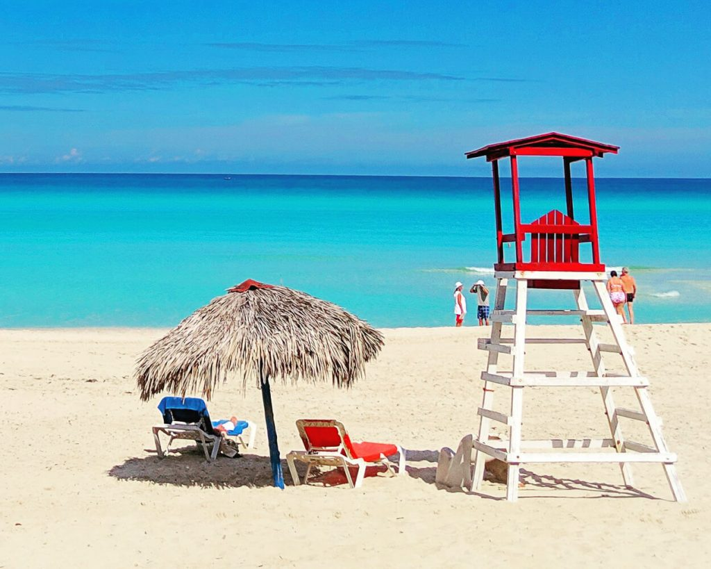 Beach chairs and lifeguard stand along Varadero Beach Cuba