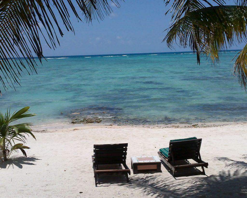 beach chairs sitting on Tankah Bay overlooking snorkeling area near Tulum Mexico